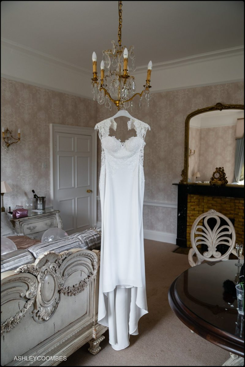 dress hanging from chandelier