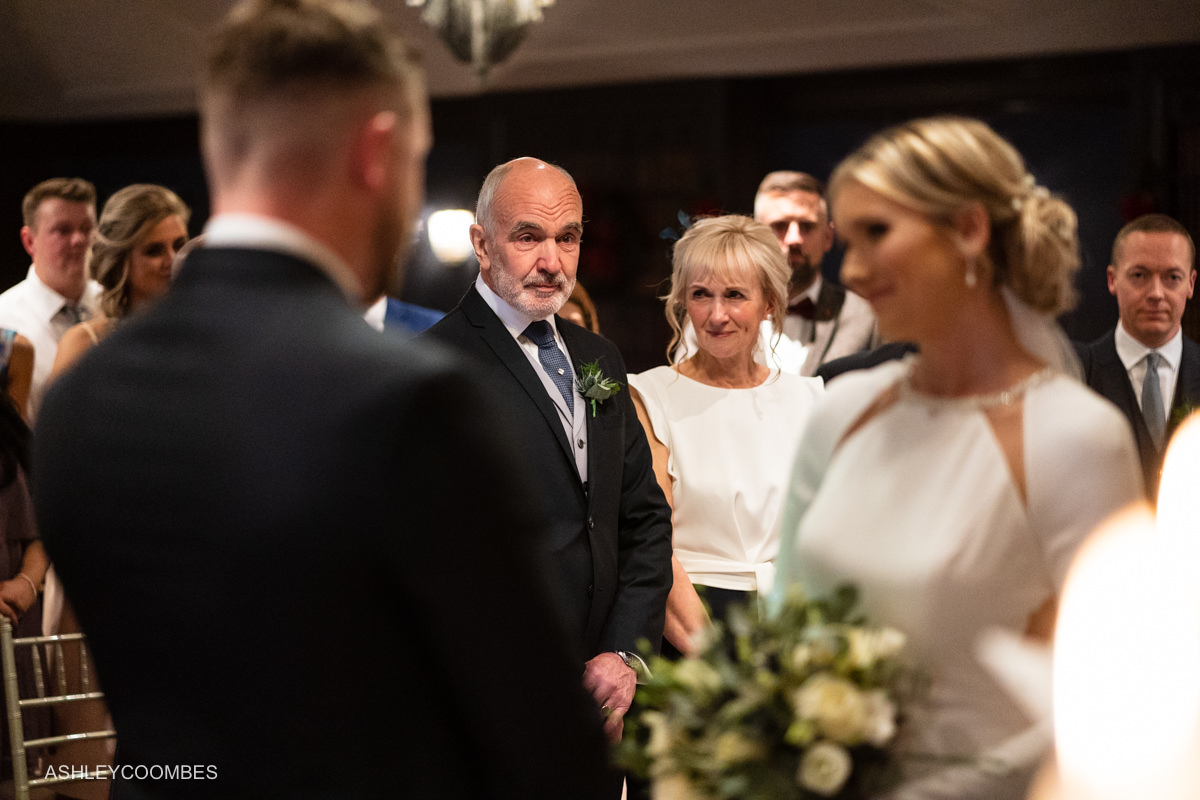 bride father looks on