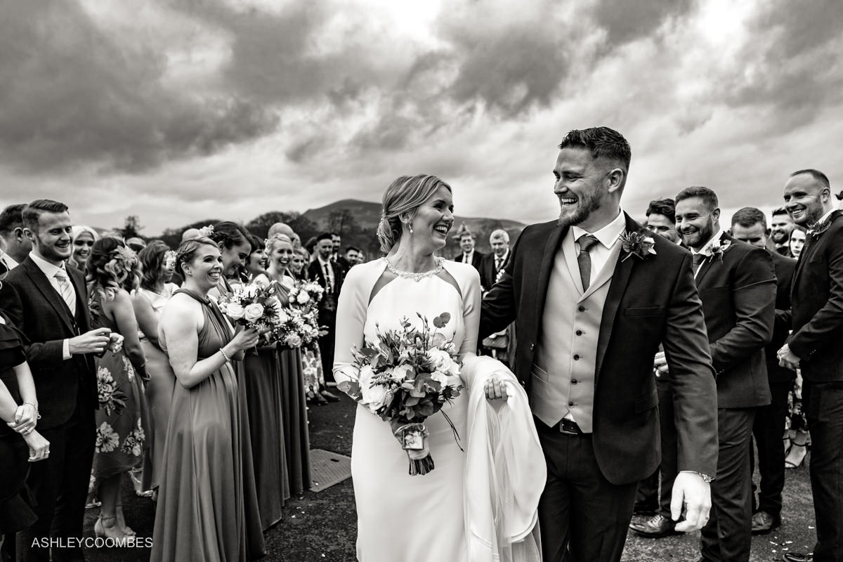 bride and groom with cloudy sky