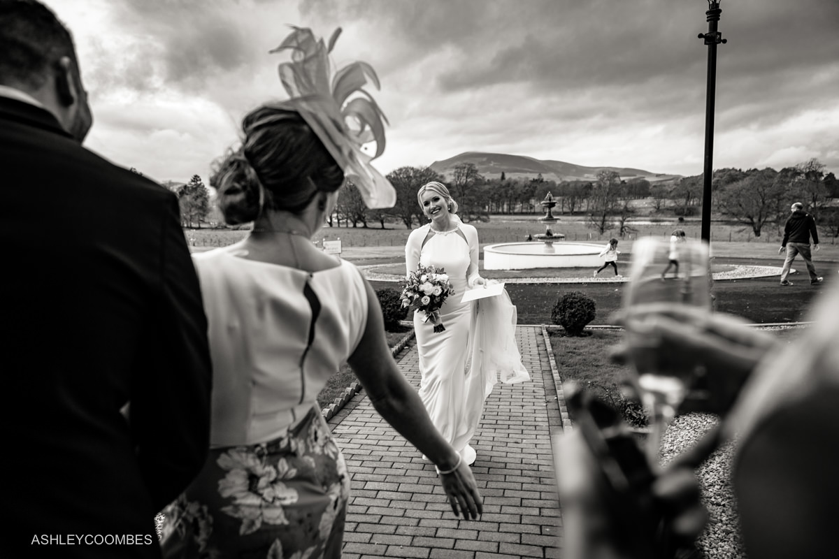wide angle layered black and white photo of bride