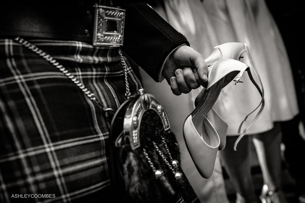 holding brides shoes