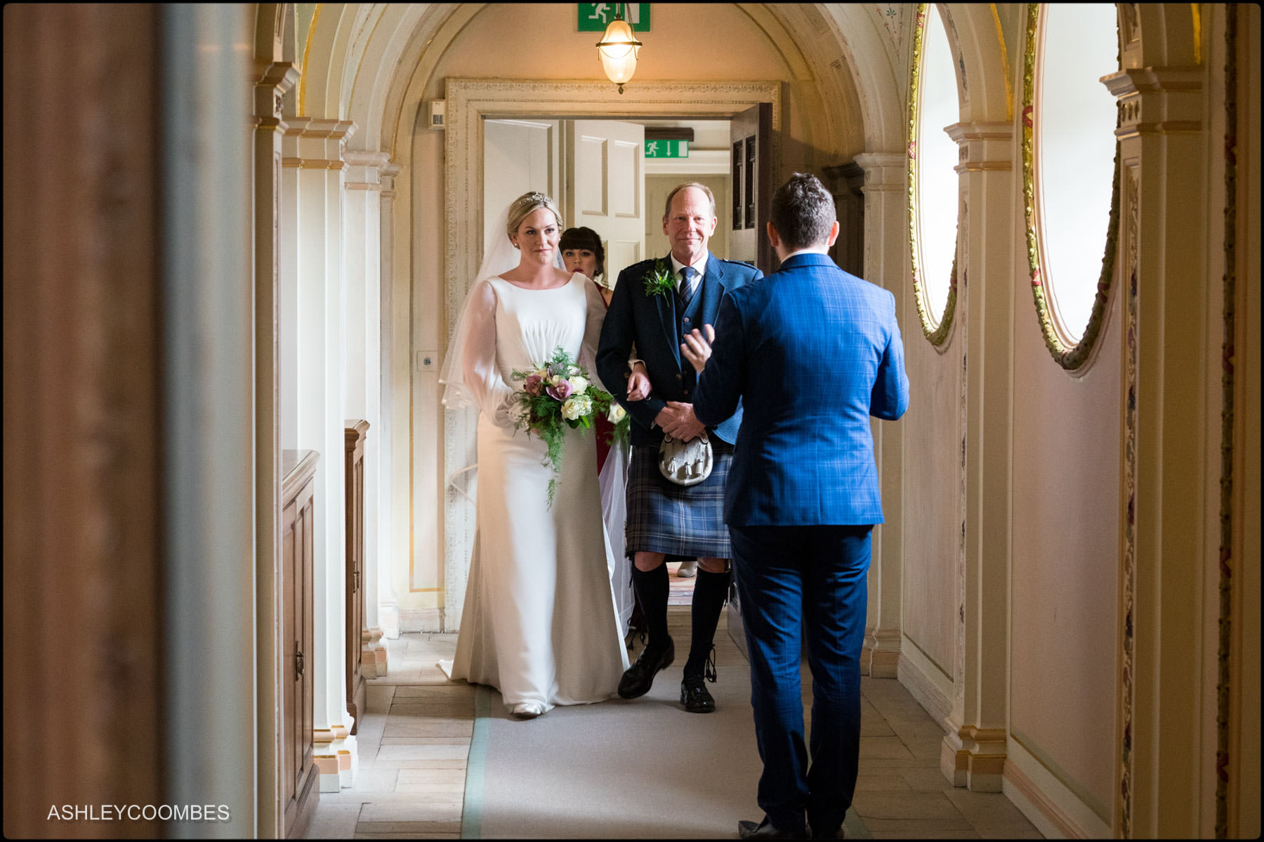 bride and dad about to enter tapestry room