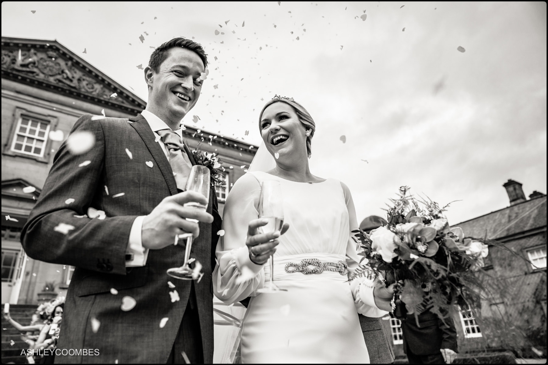 couple with confetti black and white low angle