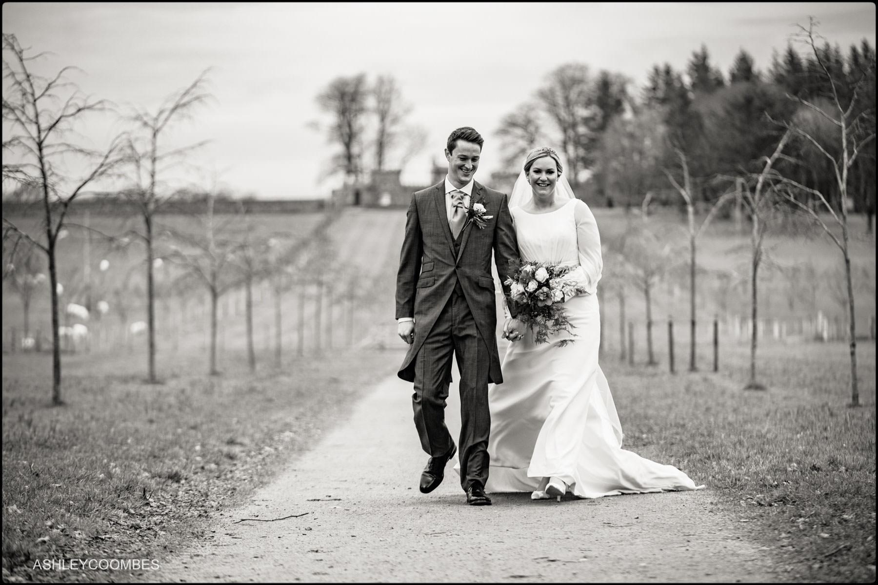 bride and groom walking full length