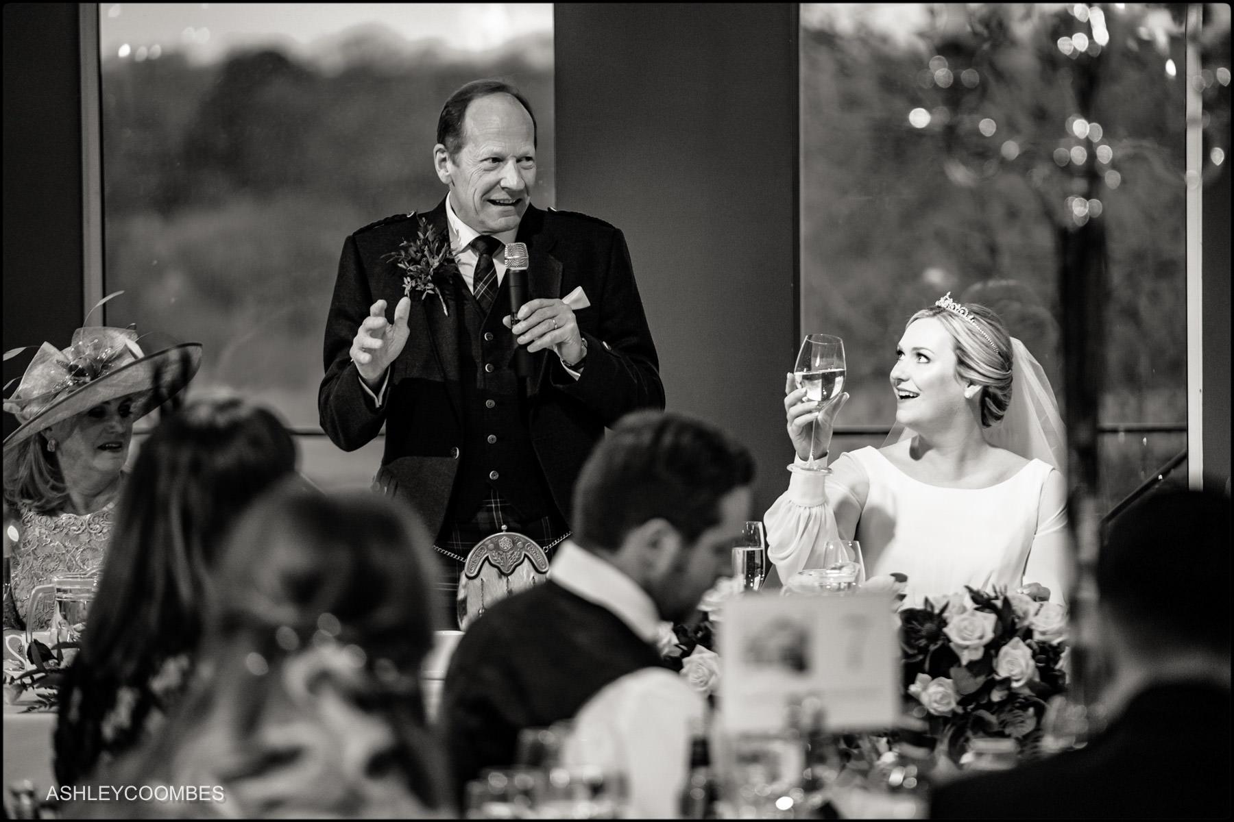 bride raises a glass