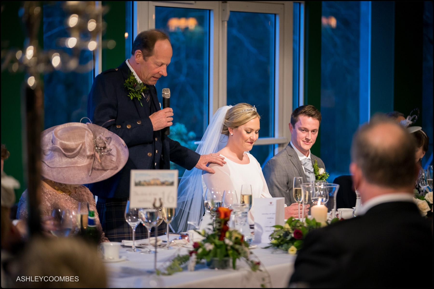 dad touches bride's shoulder during speech