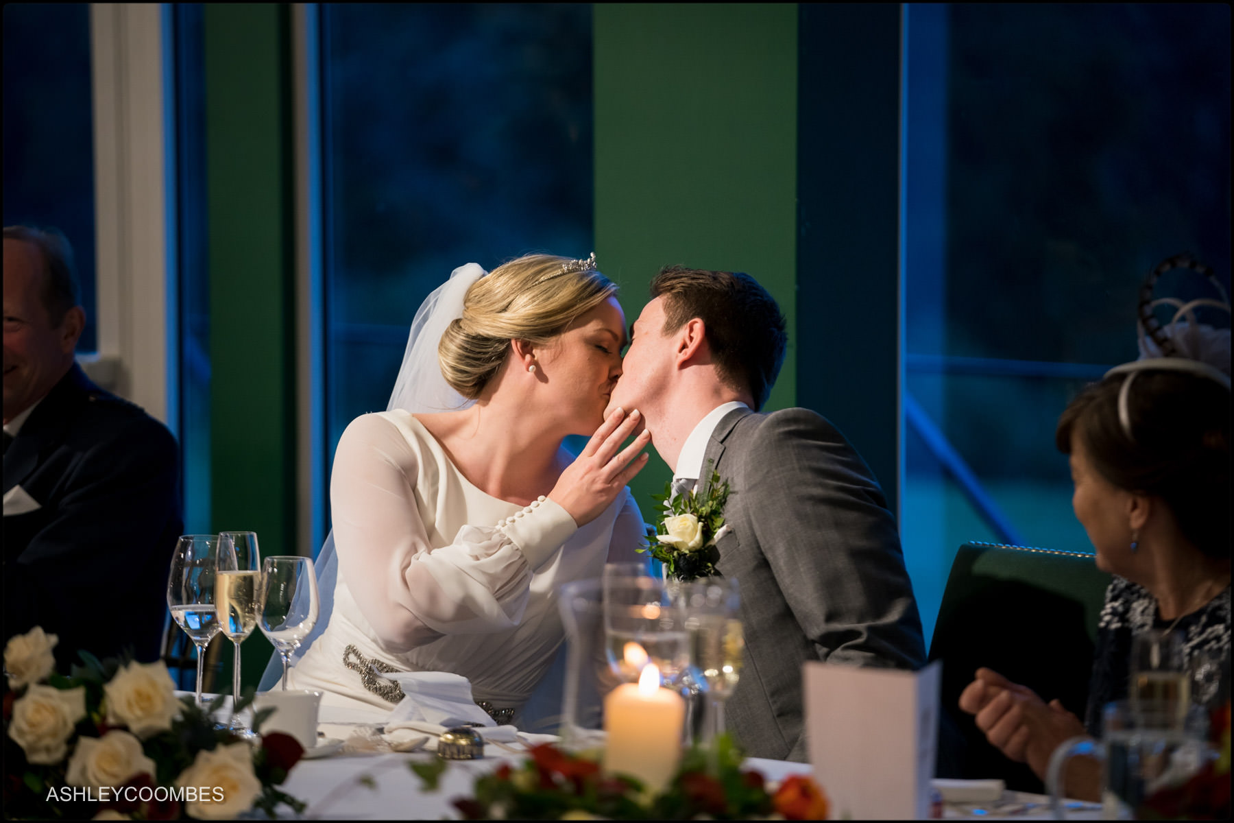 bride and groom kiss after speeches