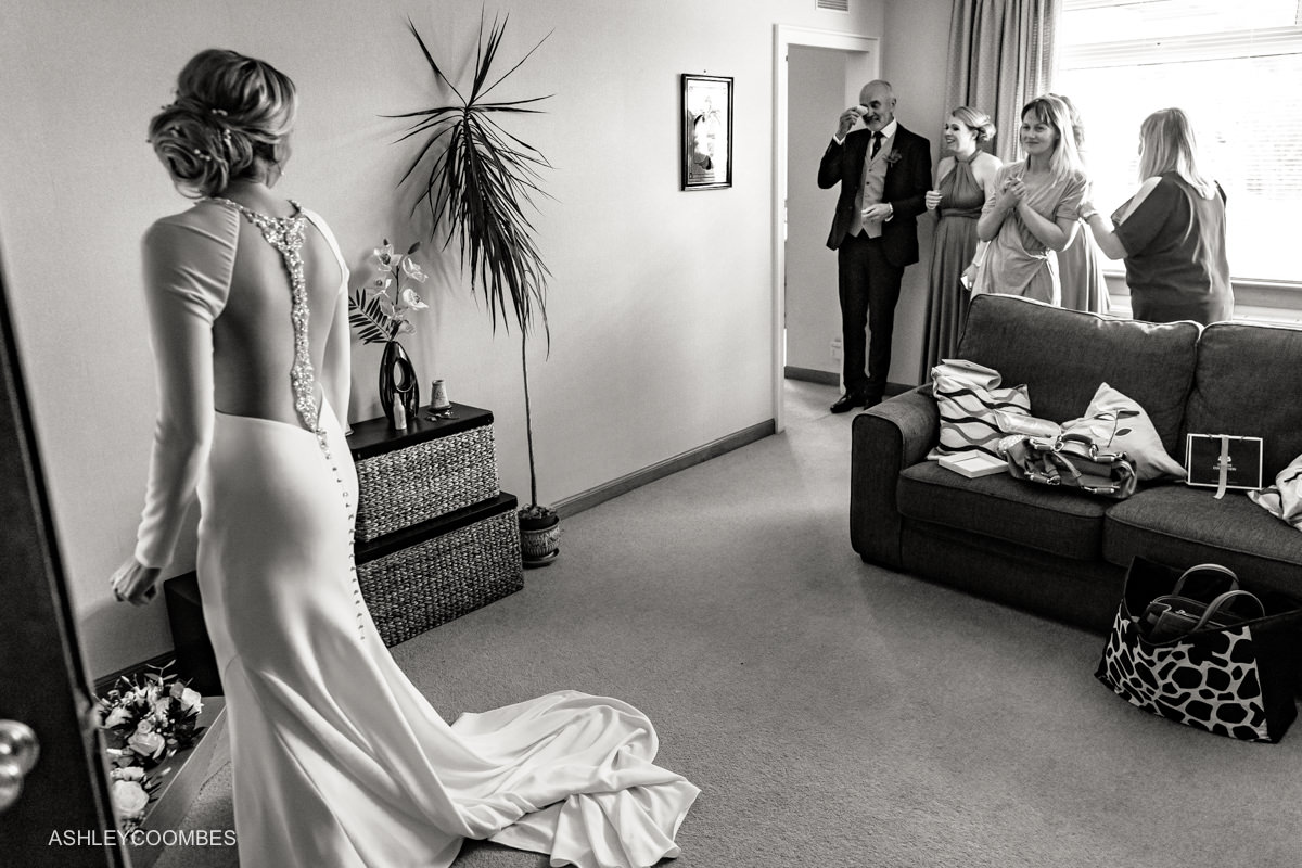 Bride father sees her in dress