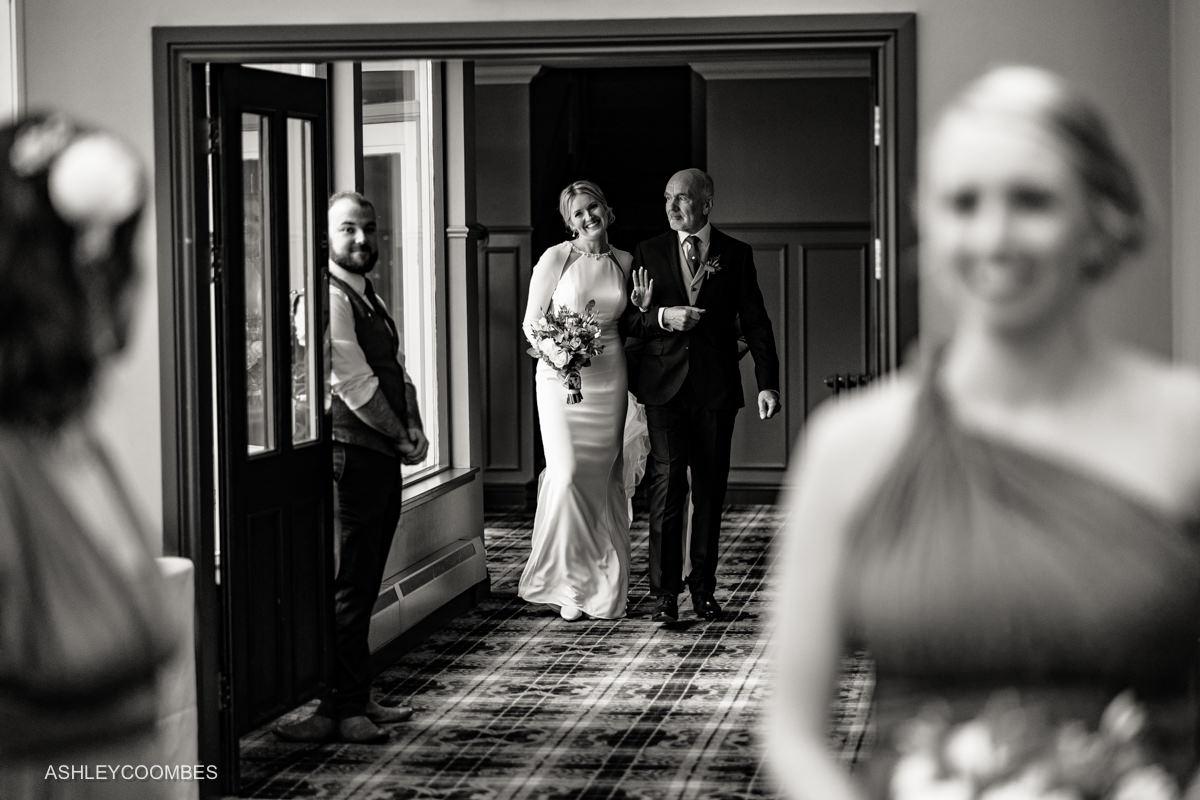 bride waves as arrives