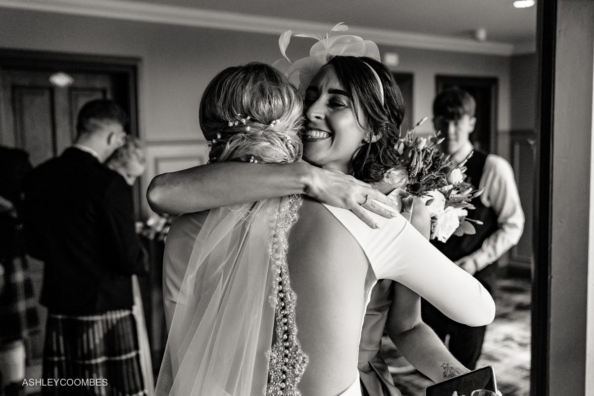 friend congratulates bride